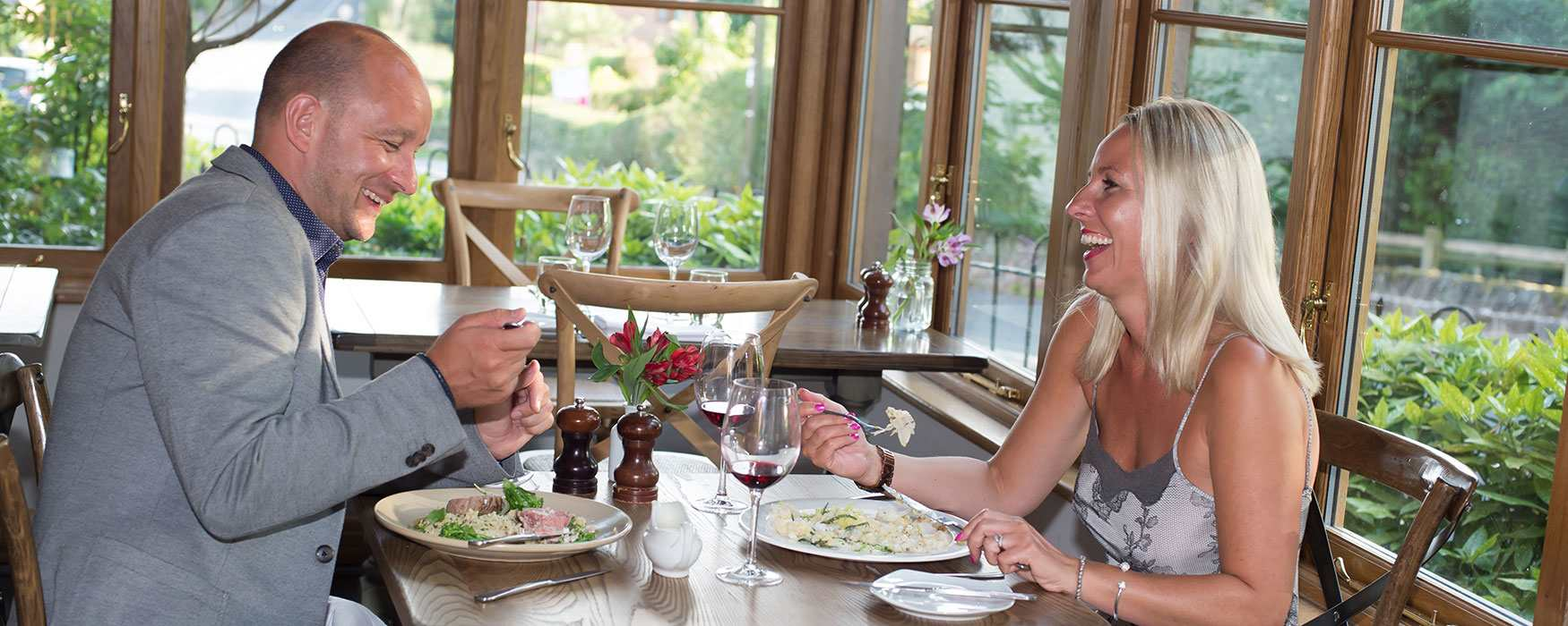 Couple enjoy a romantic meal at The Duncombe Arms, Ellastone