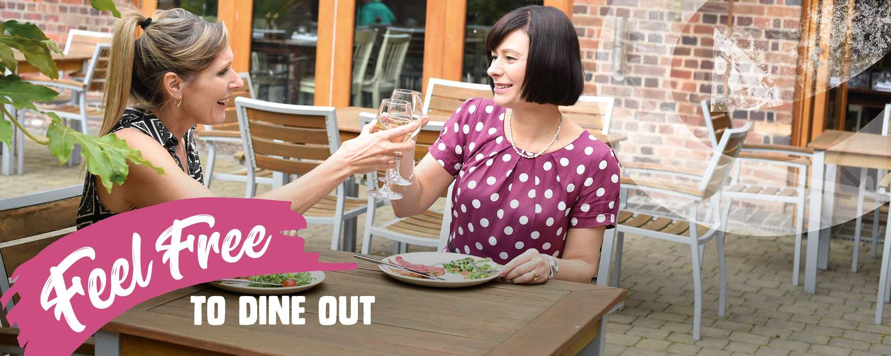 Feel Free to dine out in Staffordshire. Ladies having lunch outdoors at Weston Park's Granary restaurant.