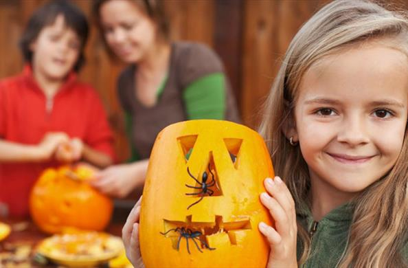 Enjoy some Halloween themed half term fun, like pumpkin carving.