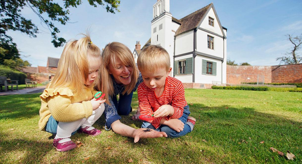 Family exploring the grounds of Boscobel House, South Staffordshire.