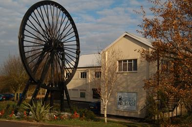 Museum exterior and wheel sculpture