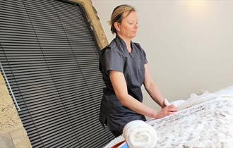 Getting the treatment couch ready at Peak Relaxation, Staffordshire
