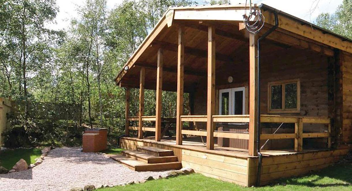 Stay in one of the timber lodges at Quarry Walk Park