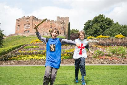 Tamworth Castle Pleasure Grounds, Tamworth, Staffordshire. Boys role playing knights in the grounds.