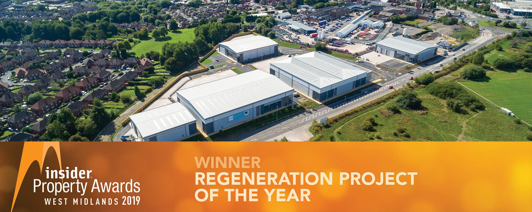 """Aerial View of Tunstall Arrow with text stating """"Tunstall Arrow, Stoke-on-Trent - Winner Regeneration Project of the Year. West Midlands Property Awards 2019."""""""