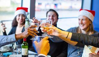 People enjoying Christmas lunch on board City Cruises