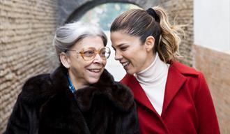 Two women in winter coats