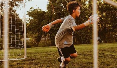 Boy playing football goalkeeper