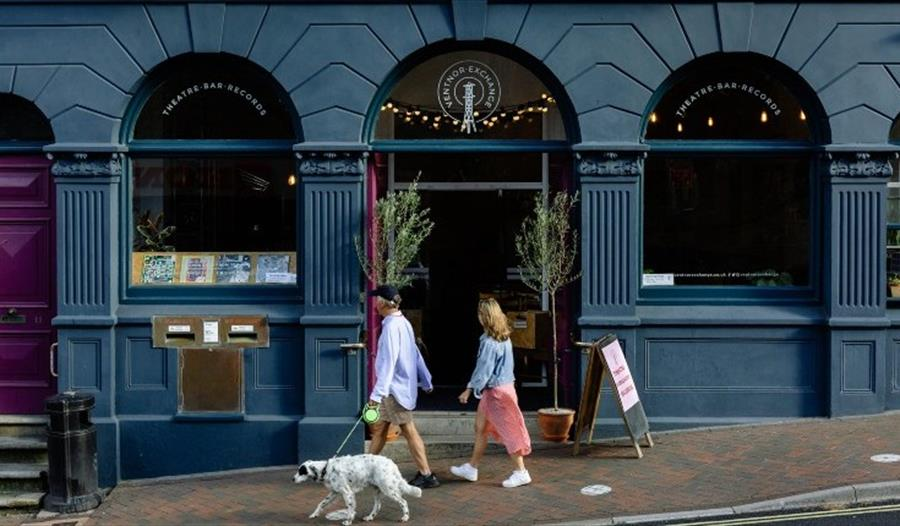 Couple with dog walking outside of Ventnor Exchange, Isle of Wight, Things to Do
