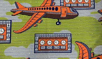 Image: Vlisco, 'Dutch Wax' cloth depicting orange planes