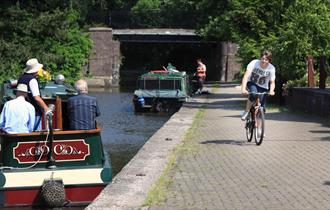 Cyclist and boaters on the Trent & Mersey Canal