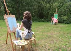 Young person painting outside