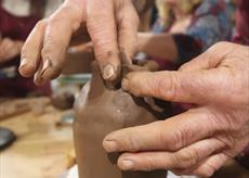 Hands moulding clay