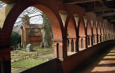 View of the watts chapel from the cloisters