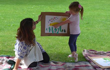 Child pointing at painting