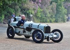 man driving old pre-war Grand Prix Car