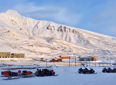 Snowmobiles parked in Pyramiden