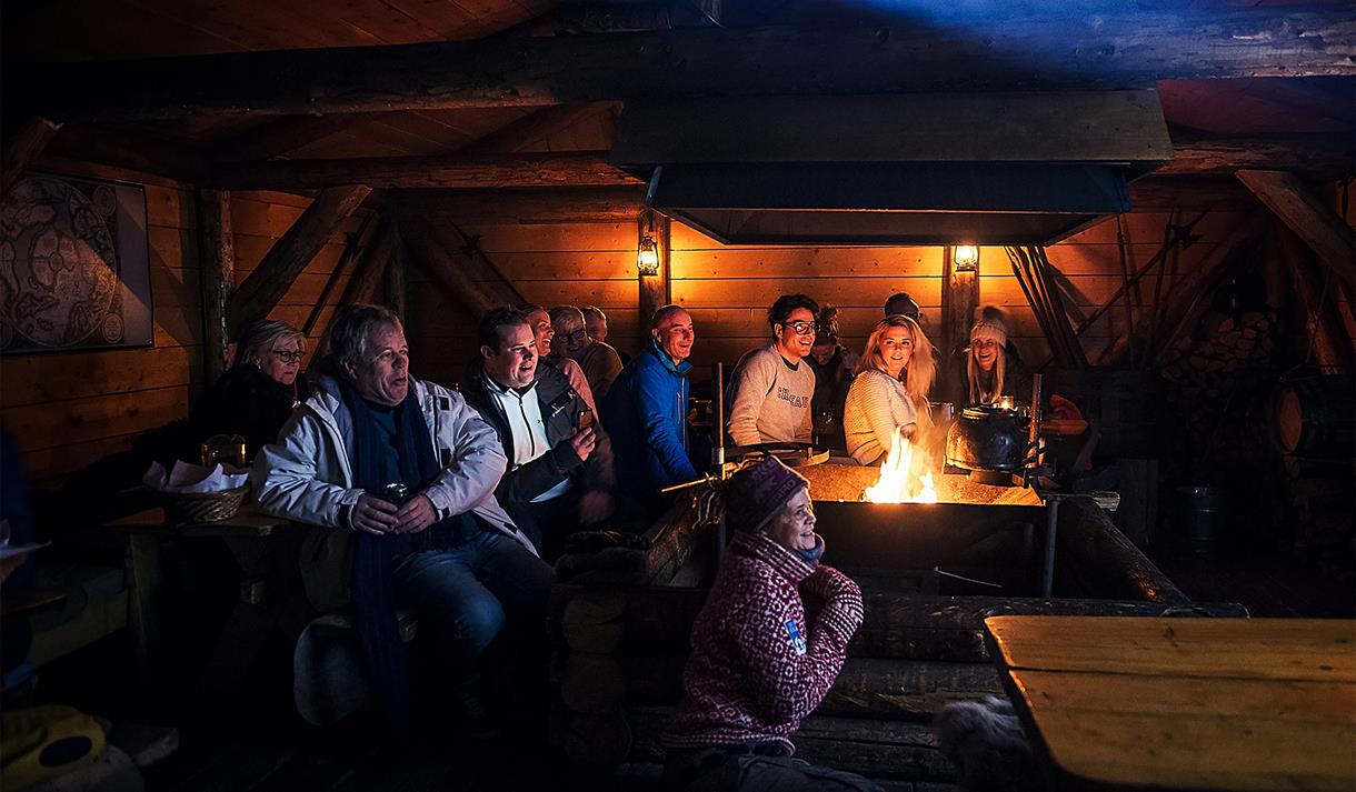 Guests listening to a lecture inside the cabin at Camp Barentz