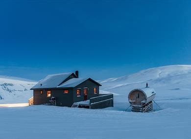 Juva Cabin underneath a blue sky