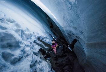 Person visiting an ice cave