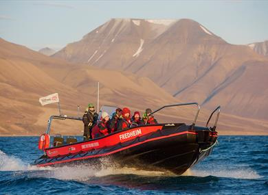 A tour group onboard a RIB boat