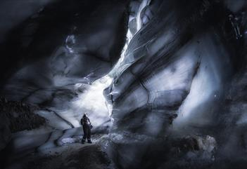 A guest looking around inside the ice cave