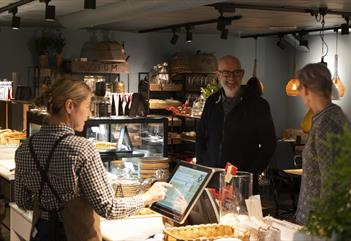 Two guests about to pay for their food at the counter