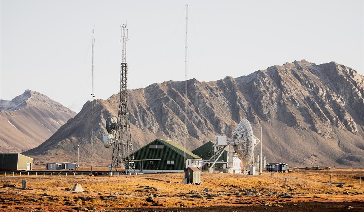 Isfjord Radio with mountains in the background