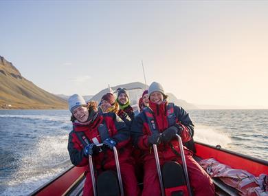 Guests having fun on board a RIB boat