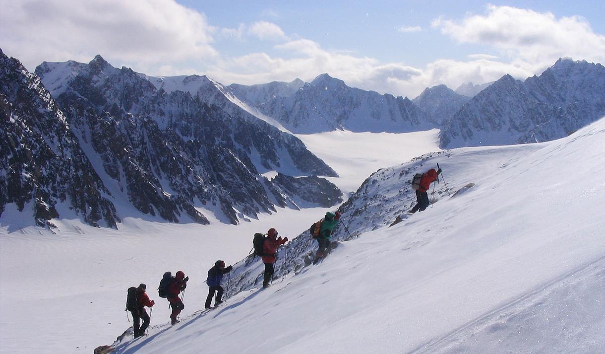 A tour group climbing a mountain