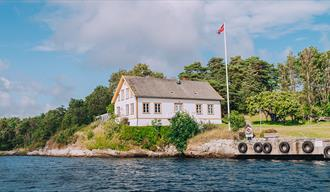 Langøya Hovedgård restaurant and cultural site seen from the water