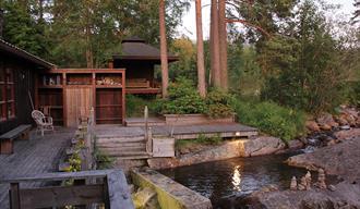 Patio and swimming pool at sauna Fossumsanden camping and cabin rental