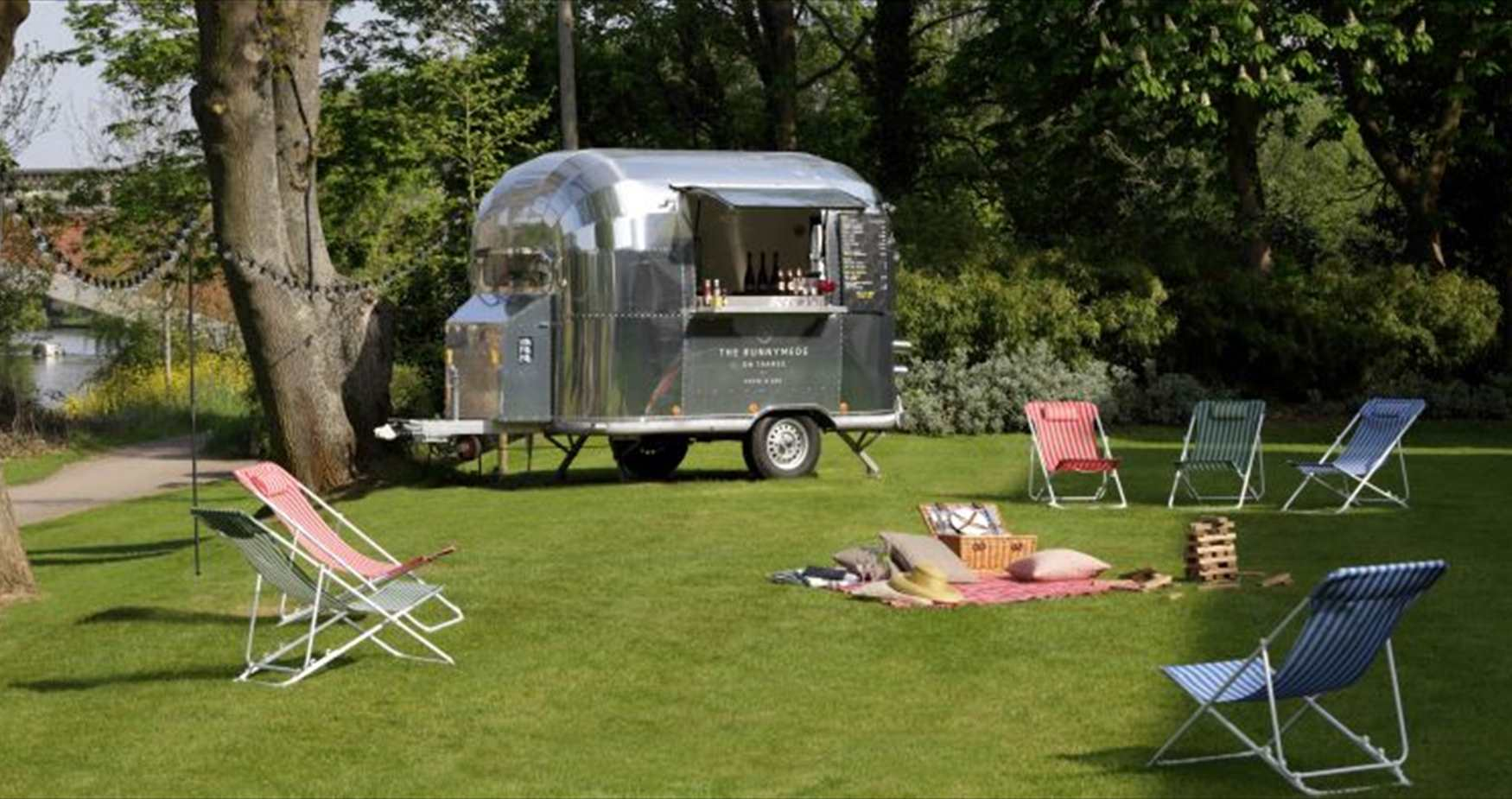 Picnic by airstream trailer at the Runnymede on Thames hotel by the River Thames near Windsor