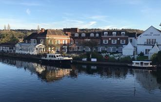 View of Macdonald Compleat Angler from river with boats moored.