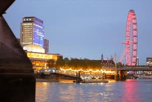 View of the London Eye at night from City Cruises