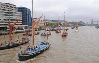 Boats on the water in front of Tower Bridge on the Thames.