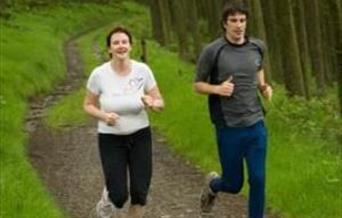 Runners running along the running trail at Bwlch Nant yr Arian.