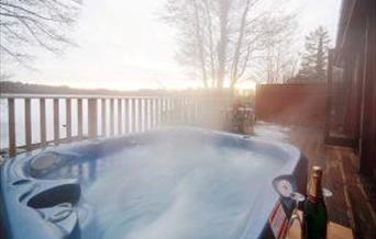 Chiffchaff lodge private lakeside hot tub.
