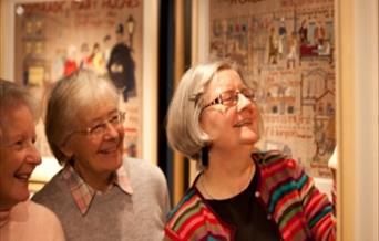 visitors exploring the Quaker Tapestry