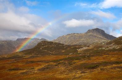 The mountain Bitihorn behind a rainbow