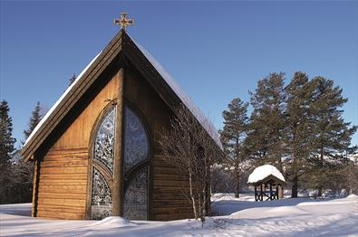 The beautiful small Chapel of Lights from the outside in winter with snow lying on the ground.