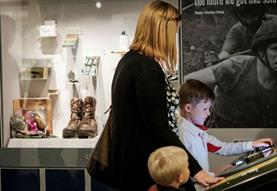 Family looking at museum display