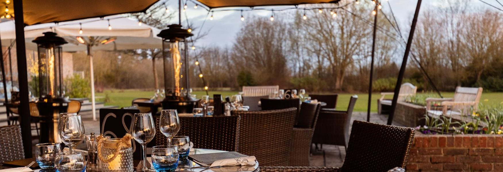 Outdoor dining terrace at Stirrups Hotel