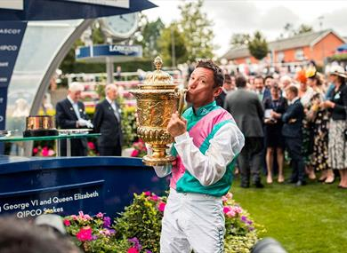 Frankie Dettori kisses the trophy | QIPCO King George Diamond Weekend at Ascot Racecourse