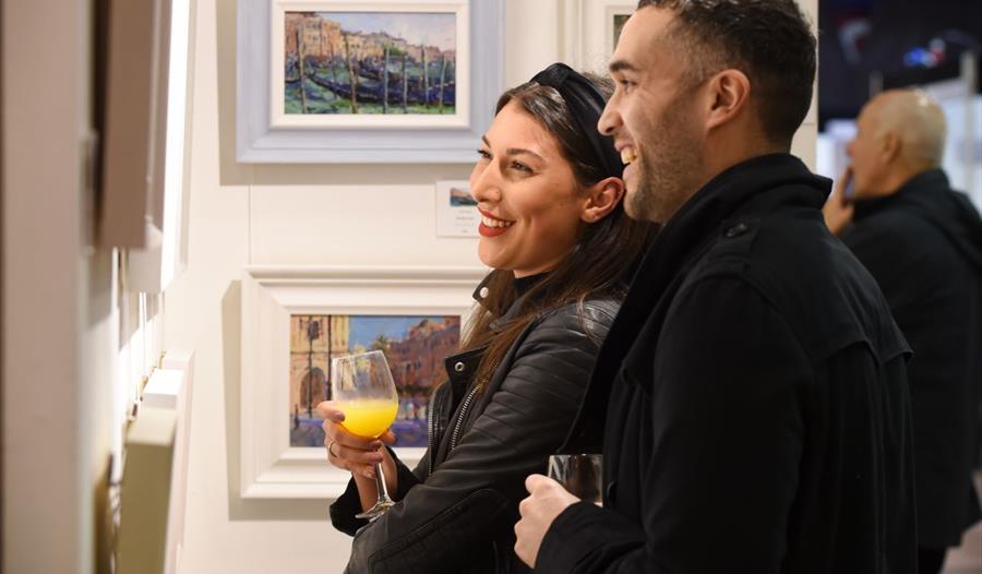 Visitors appreciating the art at Contemporary Art Fairs Windsor
