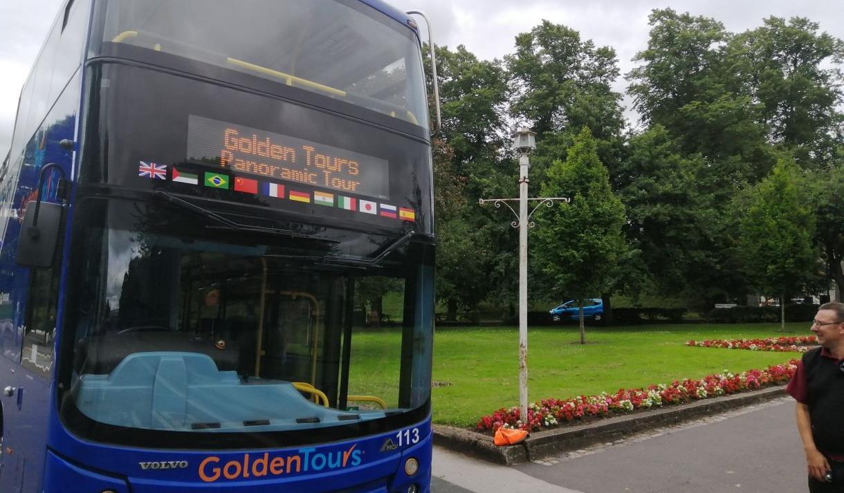 Golden Tours open top tour bus