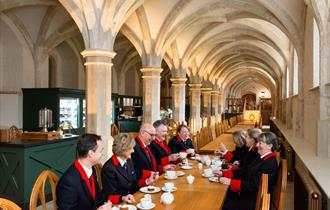 Windsor Castle wardens sample the menu at the Undercroft Cafe.  Royal Collection Trust / © Her Majesty Queen Elizabeth II