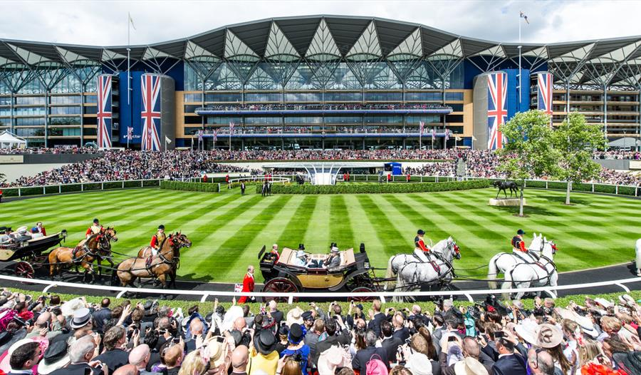 The royal family's carriage procession arrives at Royal Ascot