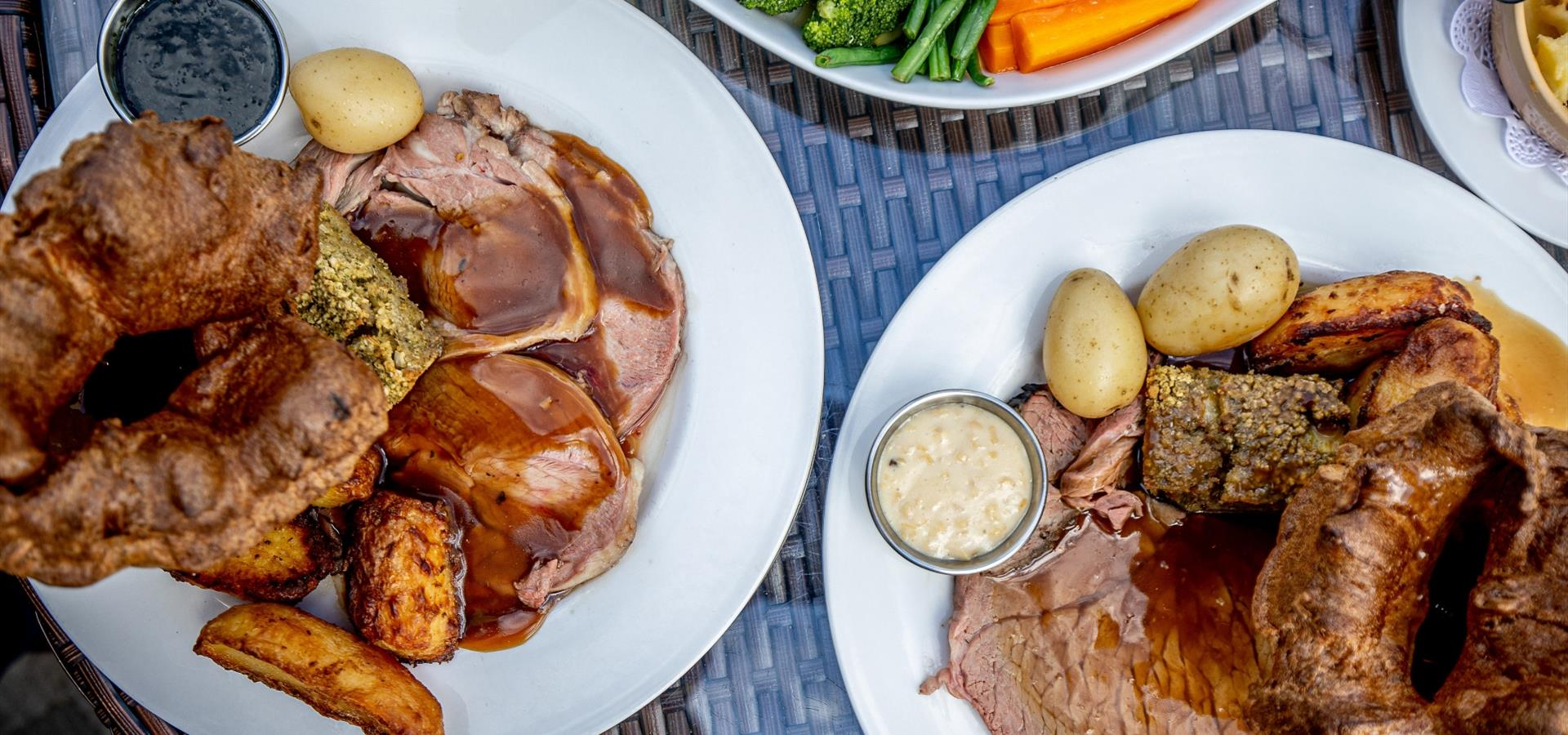 An image of a roast dinner with Yorkshire Puddings by Charlotte Graham