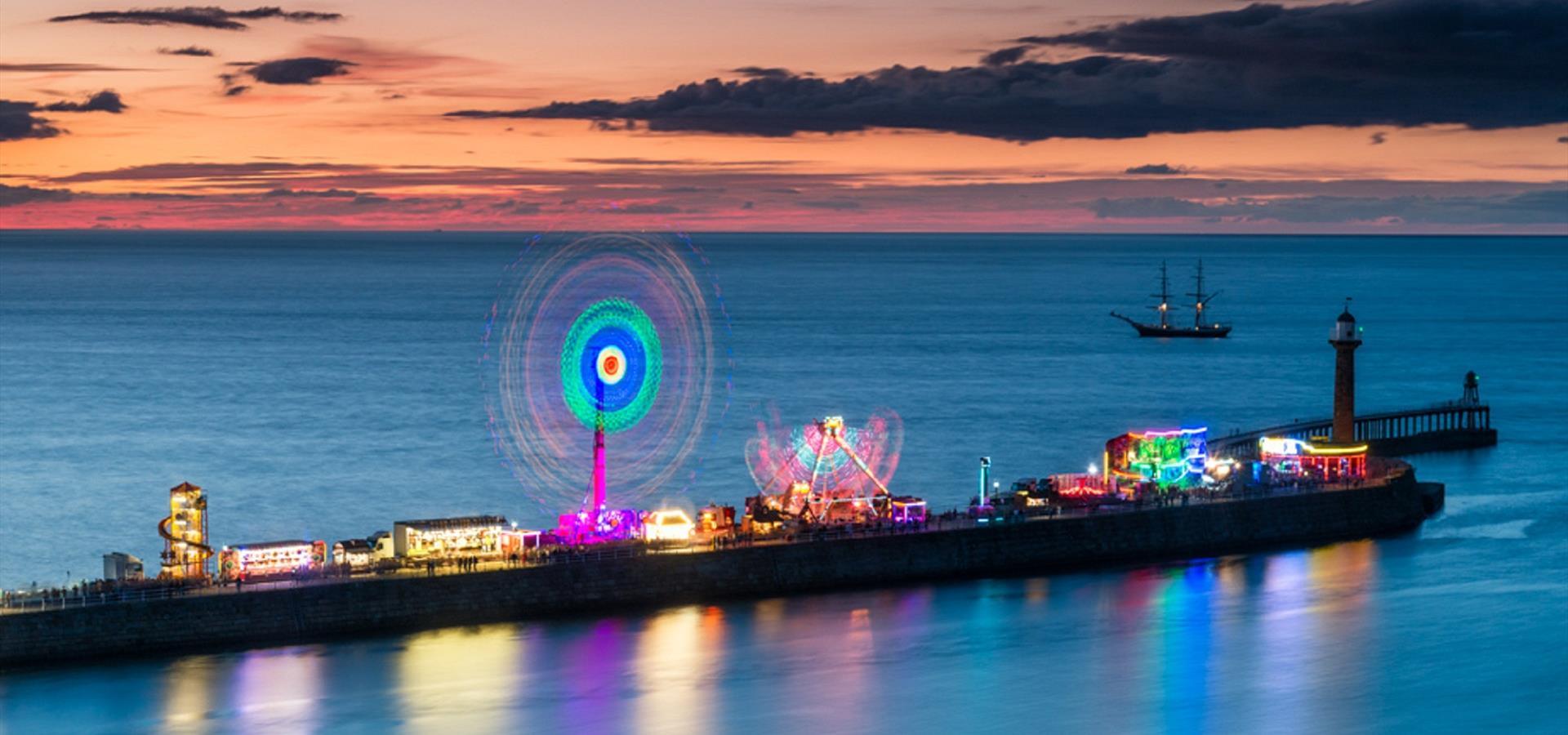 An image of the Fun Fair on Whitby Pier by Richard Burdon